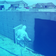 Spraying Waterproofing Material on exterior walls